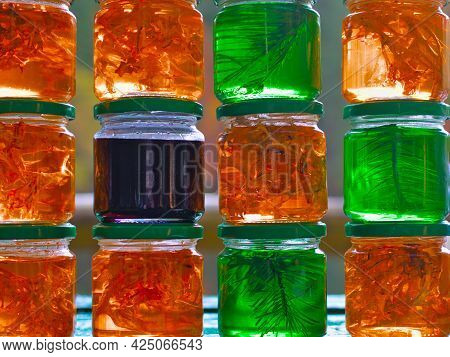 A Set Of Small Jars Of Different Colors With Jam Without Labels. Jars Of Jam In A Row. Honey And Jam