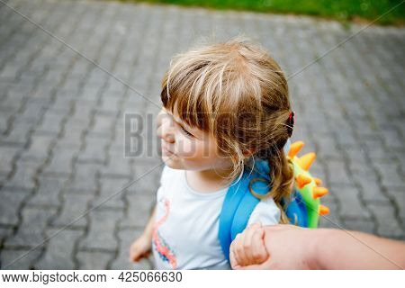 Mother Accompanies Preschool Girl To Daycare Or School. Mom Encourages Student Child To Accompany He
