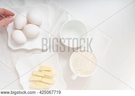 Preparing Ingredients For Baking. Butter, Flour And Butter For Dough. Recipe Ingredients.