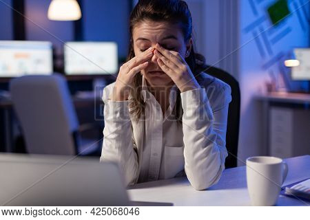 Tired Woman Fall Asleep Checking Financial Analyze Late At Night In Start-up Business Office. Exhaus