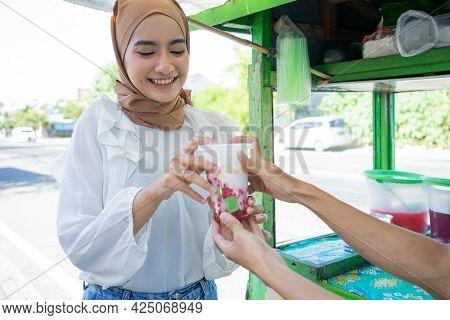 A Pretty Girl In A Headscarf Buy Es Campur In A Plastic Bag