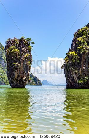 Thailand. Ko Tapu - James Bond Island. Warm gentle Andaman sea and blue sky, picturesque cliffs overgrown with moss and grass. Travel to a fabulous warm country.