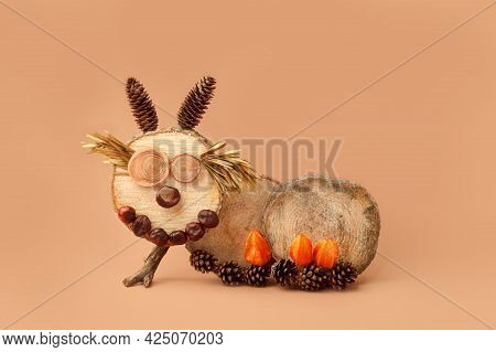 Seasonal Autumn Craft With Kids. Children's Cute Worm Or Caterpillar Made Of Natural Materials - Con