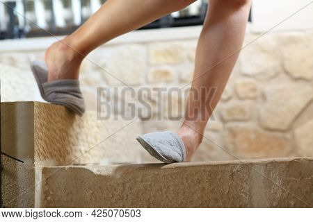 Close Up Of A Woman Legs Stumbling And Spraining Ankle Going Down The Stairs
