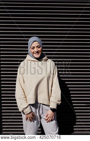 Vertical Graphic Portrait Of Modern Middle-eastern Woman Wearing Headscarf And Looking A Camera Whil