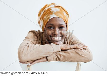 Portrait Of Modern African-american Woman Smiling At Camera And Wearing Headscarf While Posing Again