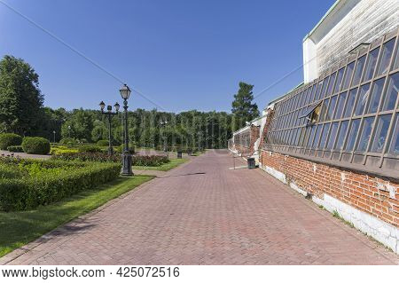 Moscow, Russia - June 20, 2021: Walking Path Along The Facade Of The Vineyard Greenhouse In Tsaritsy