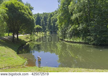 Moscow, Russia - June 20, 2021: A Little Boy Stands On The Shore Of A Pond. Tsaritsynsky Park, Mosco