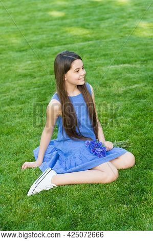 Rest And Recreation Trip. Happy Child Rest On Green Grass. Enjoying Rest During Vacation. Summer Res