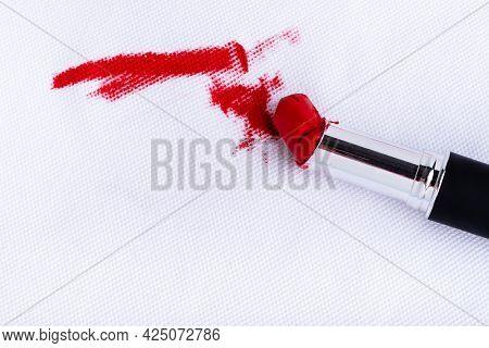 Red Lipstick Stain On Cloth Fabric From Accident. Dirty Stains In Daily Life For Cleaning Concept. H