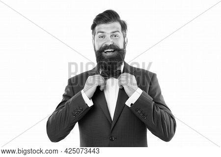 Man In Elegant Custom Tailored Expensive Suit. Happy Man In Suit Fixing Tie. Successful Man Smiling.
