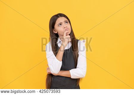 Imaginative Girl Child In School Uniform Keep Thinking Yellow Background, Imagination