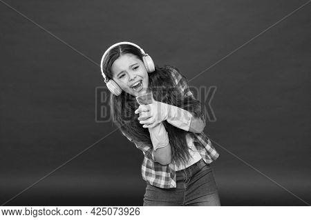 Cleaning Party. Girl Wear Headphones And Protective Gloves For Cleaning. Listening Music And Cleanin