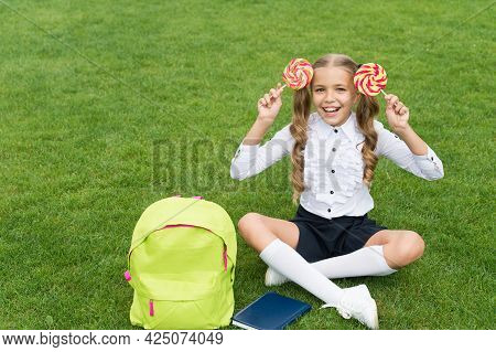 Education Gives Sweet. Funny Child Hold Lollipop. Concept Of Education. Ordinary Learning Day. Cute