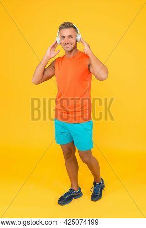 Music For Fitness. Sportsman Listen Music. Sportsman Training. Strong Sportsman Wear Headphones And