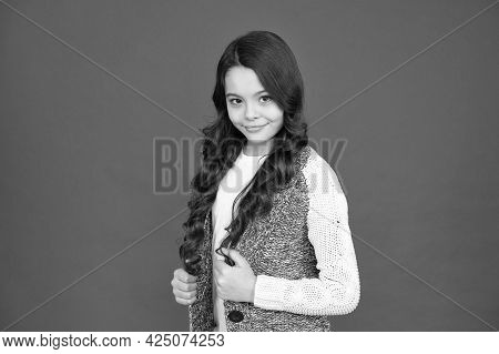 Child Psychology And Development. Confident Posture. Adorable Smile. Natural Curls. Kid Cute Face Ad