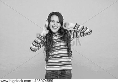 Catch My Wave. Small Girl Listen Music In Headphones. Audio Book Literature For Children. Teen Kid E