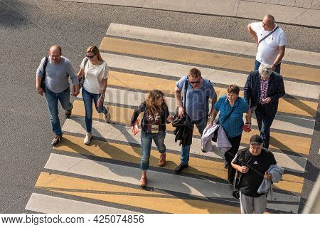 Moscow, Russia, September 6, 2019 - Top View Of People Crossing A Pedestrian Crossing