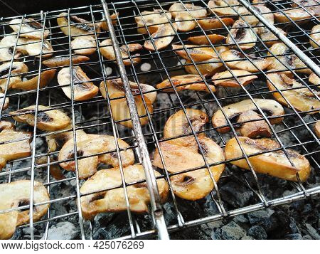 Vegetarian Menu. Tasty Delicious Champignons Are Cooked On Coals. Grilled Mushrooms Roasting On Bbq