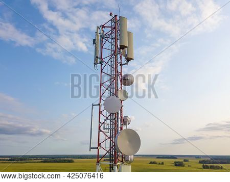 Close-up View From A Drone Of A Telecommunications Tower In The Countryside Against The Sky With Clo