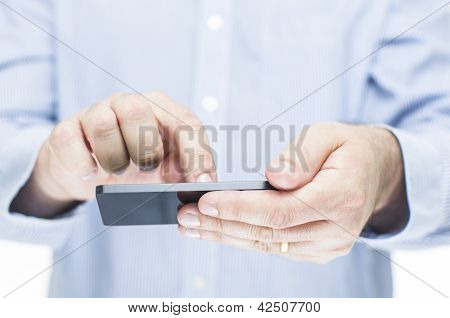 Man Operating A Touchscreen Mobile Phone