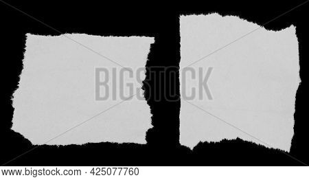 Two pieces of torn newspaper on black background