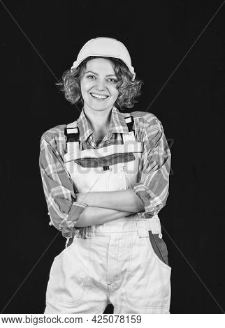 Female Engineer In Hardhat. Woman Architect In Checkered Shirt Inspecting Construction. Building Pro