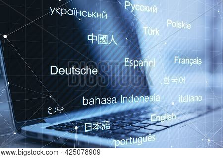 E-learning. Close Up Of Notebook With Creative Digital Languages Mesh On Blurry Background. Online D