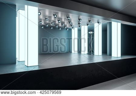 Side View Of Modern Glowing Exhibition Hall Stage In Concrete Interior. Museum And Gallery Concept.