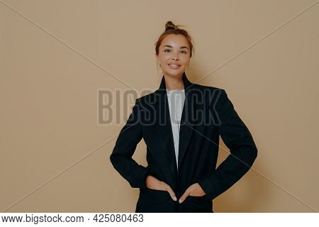 Stylish Caucasian Business Woman In Black Suit With Hair Tied Up In High Bun And With Light Makeup P