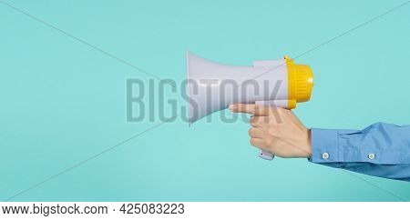 Male Hand Is Hold Megaphone And Wear Blue Long Sleeve Shirt On Green Or Mint Or Tiffany Blue Backgro