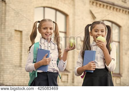 Students Girls Classmates With Backpacks Having School Lunch, Eating Apple Concept