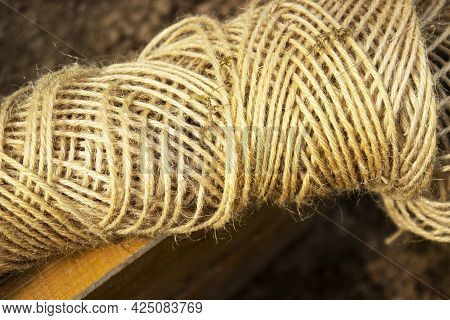 A Ball Of Twine On A Dark Background
