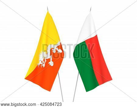 National Fabric Flags Of Madagascar And Kingdom Of Bhutan Isolated On White Background. 3d Rendering