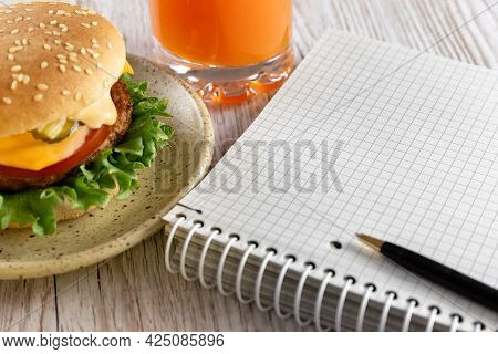 Student Lunch. A Quick Snack For Businessmen, Schoolchildren, Students. Notebook, Delicious And Heal