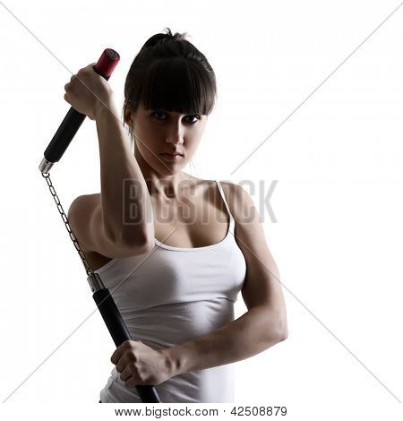 sport karate girl doing exercise with nunchaku, fitness woman silhouette studio shot over white background