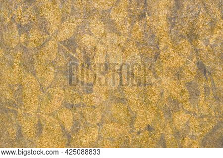 Metallic gold leaves patterned background