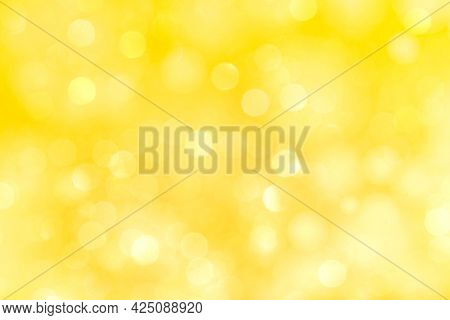 Yellow bokeh patterned texture background