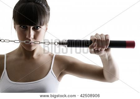 portrait of sport karate girl with nunchaku, fitness woman silhouette studio shot over white background