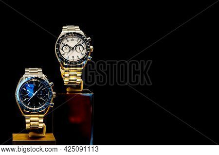 Elite Men's Wristwatches On A Metal Bracelet On A Black Background. Copy Space.