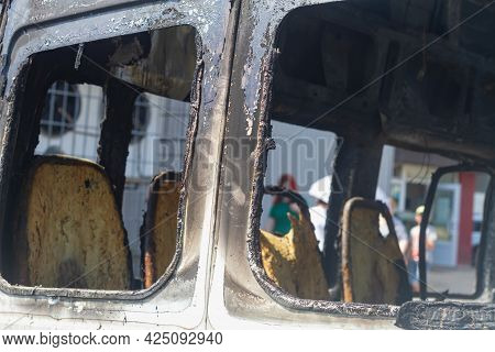 The Burnt-out Interior Of The Bus, The Burned Passenger Seats After The Fire.