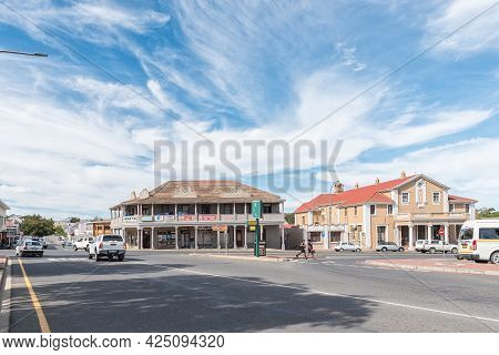 Caledon, South Africa - April 12, 2021: A Street Scene, With Old Buildings, People And Vehicles, In