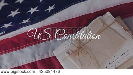 Composition of text us constitution, over antique documents and american flag. patriotism, independence and american constitution celebration concept digitally generated image.