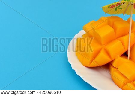 Sliced mango Served In White Plate On Colorful Background.