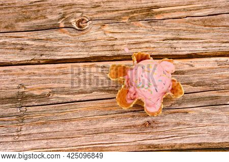 Strawberry Ice Cream In Edible Basket. Basket With Ice Cream On Wooden Table With Yellow Background.