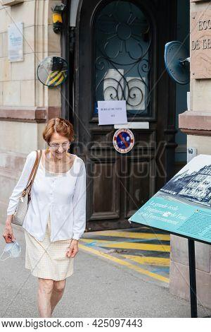 Strasbourg, France - Jun 27, 2021: Happy Senior Woman Exits French Polling Station Sign Bureau De Vo