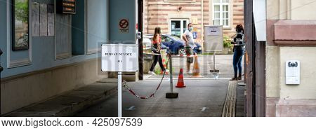Strasbourg, France - Jun 27, 2021: Workers Waiting For Visitors At French Polling Station Sign Burea