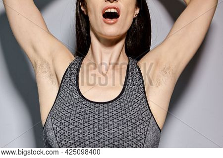 A Woman Raised Her Hand To Show The Hair Under Her Armpits. A Natural Girl With Unshaven Armpits. Fe