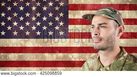 Composition of male soldier in cap looking away, against american flag. patriotism, independence and military concept digitally generated image.