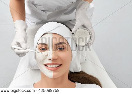 Top View Portrait Of Attractive Smiling Young Woman On Cleaning Face In Beautician. Concept Of Speci